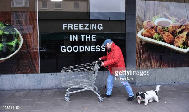 Man is seen shopping at Farmfoods supermarkets with his dog at the Market Town of Leek on November 11, 2020 in Leek, England. The United Kingdom will...