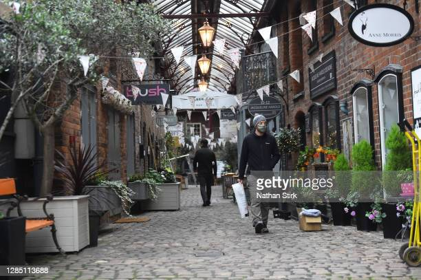 Man is seen shopping in the Market Town of Leek on November 11, 2020 in Leek, England. The United Kingdom will continue to impose lockdown measures...