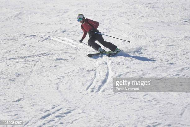 Man is seen skiing on April 3, 2021 in Glencoe, Scotland. Temperatures are due to drop with snow expected in Northern Scotland on Easter Monday.