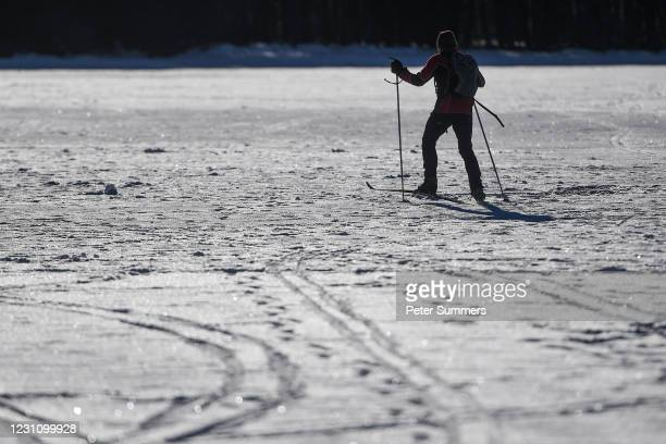 Man is seen skiing on Loch Morlich after it froze on February 11, 2021 in Aviemore, United Kingdom. The village of Carrbridge in Badenoch and...