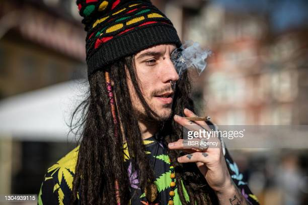 Man is seen smoking a joint at an outing of the Canna-voting-bus of cannabis-stemwijzer.nl on March 2, 2021 in Rotterdam, Netherlands. The bus is...
