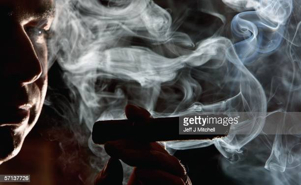 A man is seen smoking in a cigar shop March 20 in Glasgow Scotland Smoking in public places in Scotland will be banned from the morning of March 26...