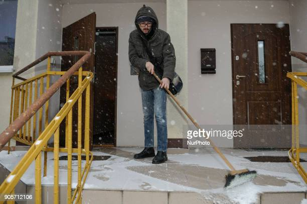 A man is seen snovelling snow in front of his house in Bydgoszcz Poland on January 16 2018 More snow is expected for the coming days across the...