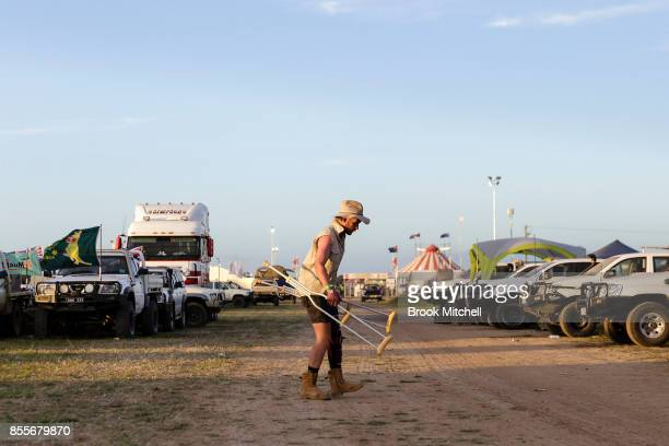A man is seen struggling to walk at dawn on day two of the 2017 Deni Ute Muster on September 30 2017 in Deniliquin Australia The annual Deniliquin...