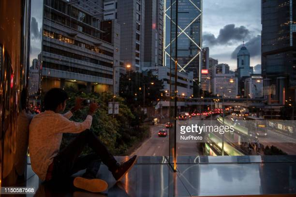 A man Is seen talking a photo with his phone in Hong Kong China 18 June 2019