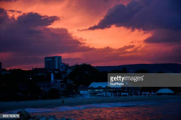 man is seen walking along the central beach of the Bulgarian Black Sea city of Varna during the sunset over The temperatures of the weather reaches...