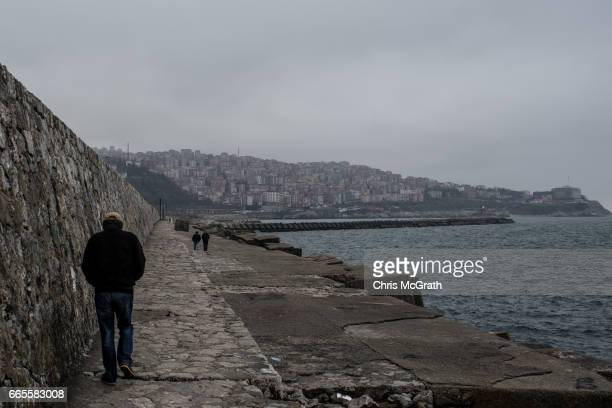 Man is seen walking in the port area on April 5, 2017 in Zonguldak, Turkey. More than 300 kilometers of coal mineÕs riddle the mountains of...