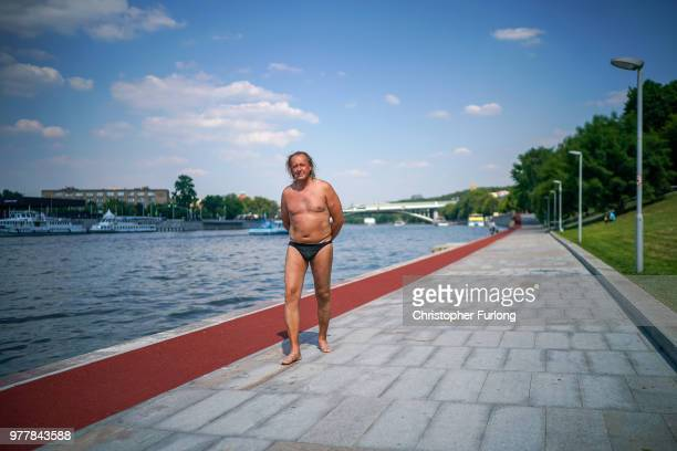 A man is seen walking on the banks of the Moscow River on June 18 2018 in Moscow Russia