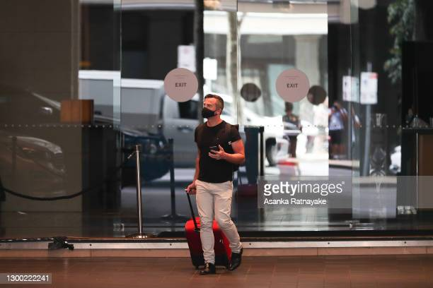 Man is seen walking out of the Grand Hyatt hotel on February 04, 2021 in Melbourne, Australia. Victoria has reintroduced COVID-19 restrictions after...