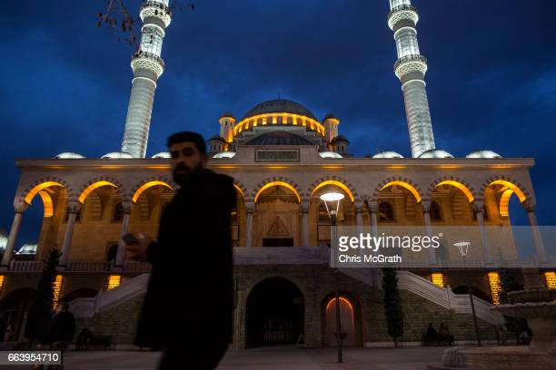 A man is seen walking past a mosque on April 1 2017 in Konya Turkey Konya with a population of more than 17million is an AKP stronghold It is famous...