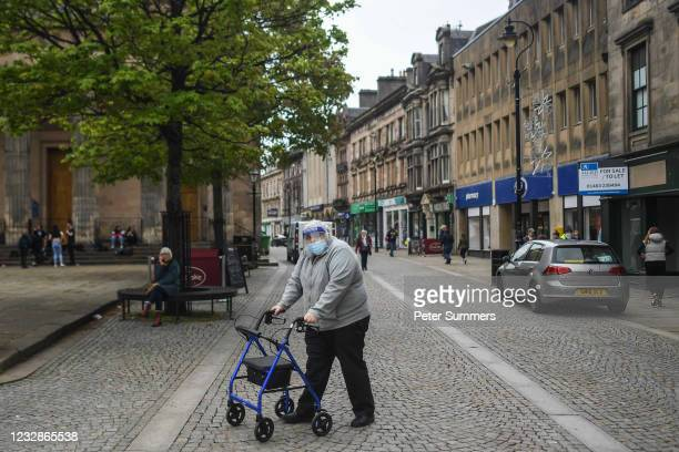 Man is seen wearing a face shield and mask on May 13, 2021 in Elgin, Scotland. Scotland's First Minister Nicola Sturgeon has announced that Moray may...