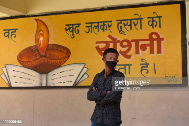 A man is seen wearing a facemask as a precautionary measure on day ten of the 21day nationwide lockdown to curb the spread of coronavirus at...