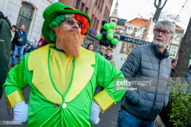 A man is seen wearing a leprechaun costume during the celebration St Patrick's day was celebrated for the ninth time in the Dutch city of The Hague...