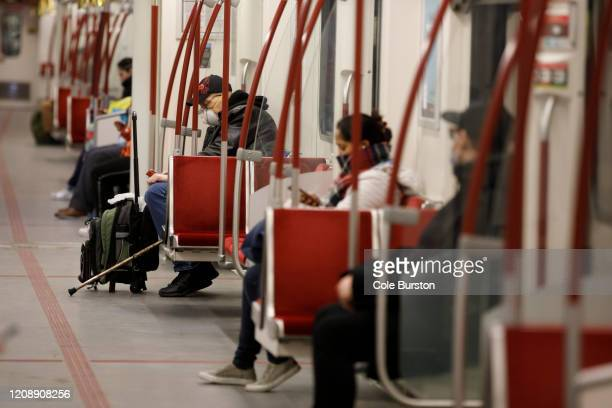 A man is seen wearing a mask in the subway during morning commuting hours as Toronto copes with a shutdown due to the Coronavirus on April 1 2020 in...