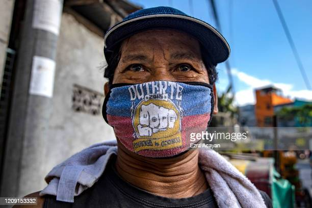 A man is seen wearing a mask with the name of President Duterte and his election campaign slogan on April 5 2020 in Quezon city Metro Manila...