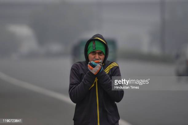 Man is seen wearing warm clothes on a cold morning, at Sarai Kale Khan, on December 29, 2019 in New Delhi, India. Severe cold wave conditions...