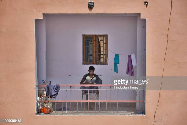 A man is seen with his cellphone on day ten of the 21day nationwide lockdown to curb the spread of coronavirus at Harkesh Nagar on April 3 2020 in...
