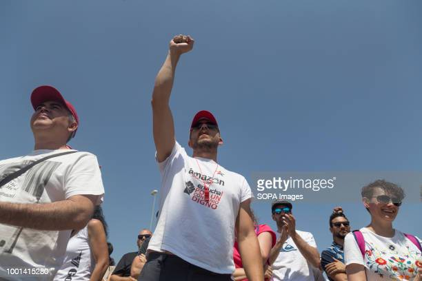 A man is seen with his fist raised during the protest A three day strike by the works council during the Prime Day demanding the company to agree to...