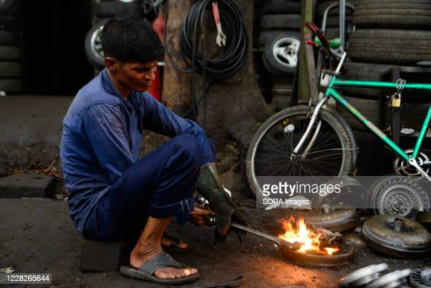 Man is seen working at Dholaikhal Automobile Spare Parts and Accessories Market.