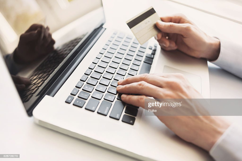 Man is shopping online with laptop : Stock Photo