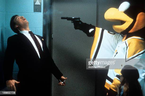 Man is shot by the mascot in a scene from the film 'Sudden Death', 1995.