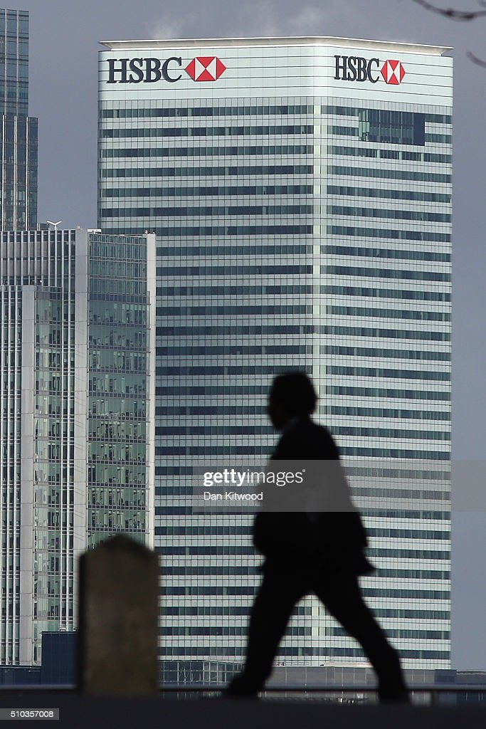 A man is silhouetted against The HSBC Holdings Plc headquarter in the Canary Wharf business, financial and shopping district on February 15, 2016 in London, England. HSBC has announced it is to keep its headquarters in London, following a review on whether to relocate abroad. The bank has had its headquarters in Canary Wharf, London since 1993.