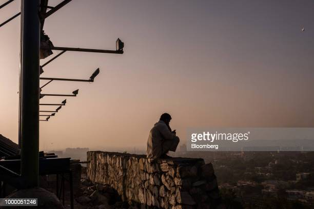 A man is silhouetted as he sits on a wall at the top of Bibi Mahru Hill in Kabul Afghanistan on Sunday July 15 2018 US President Donald last year...