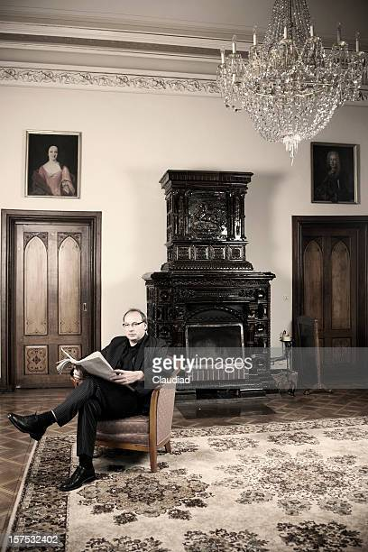Man is sitting and reading