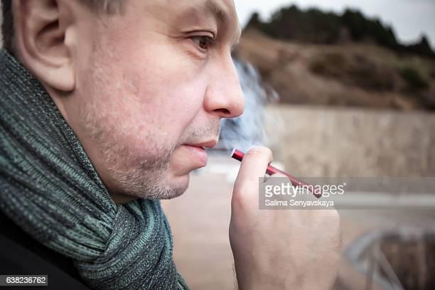 Man is smoking electronic cigarette