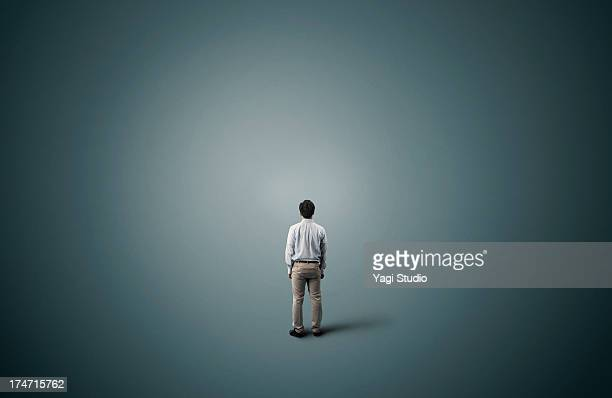 man is standing - loneliness stock pictures, royalty-free photos & images