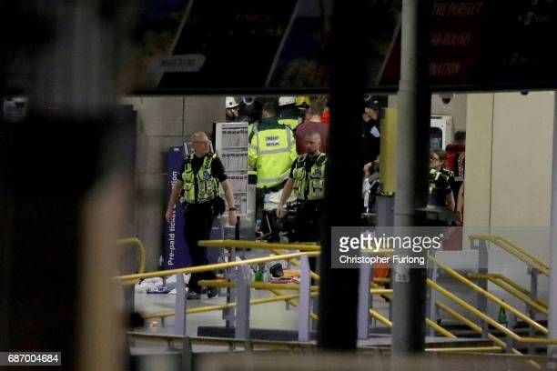 A man is stretchered out of Manchester Arena on May 23 2017 in Manchester England An explosion occurred at Manchester Arena as concert goers were...