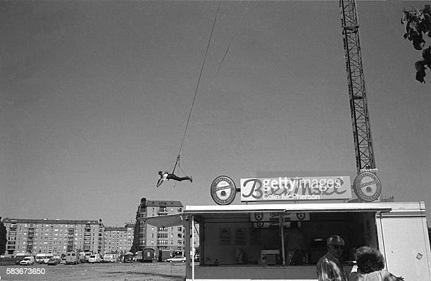 A man is suspended from a bungee rope on the former noman's land where the Berlin Wall stood During the Cold War the Wall which was built in 1961...