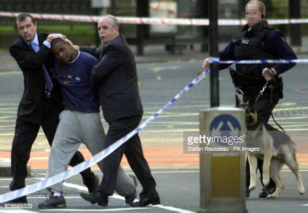 A man is taken away by police after an incident at the HSBC bank in the Victoria area of central London where up to four employees hostage Nearby...