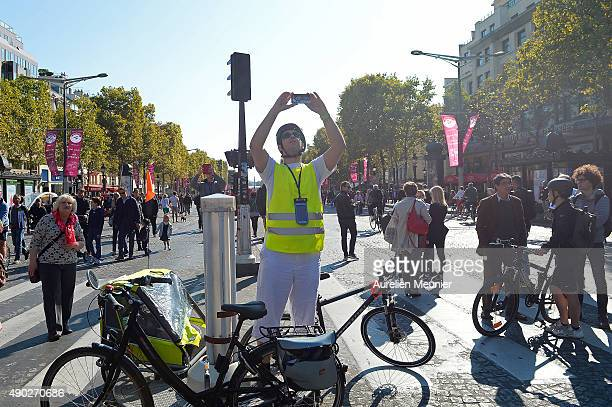 A man is taking a selfie in the middle of the Champs Elysees during the car free day on September 27 2015 in Paris France Today between 11am to 6pm...
