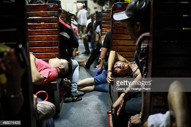 Man is taking his rest inside a hard-seat car, which is the cheapest ticket in Vietnam railway system. Trains in Vietnam are getting overwhelmed...