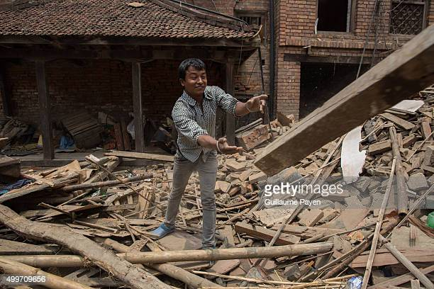 SQUARE BHAKTAPUR KATHMANDU NEPAL A man is throwing rubble as he clean the area 2 weeks after the powerful and deadly earthquake a view of the oldest...