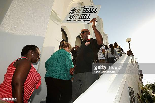 A man is told to leave his sign outside of the Sunday morning service at the historic Emanuel African Methodist Church June 21 2015 in Charleston...