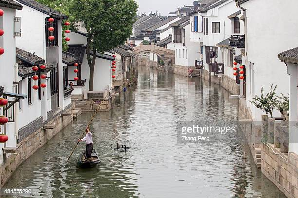 A man is training fish hawk on canal in ancient Luzhi town Luzhi Town a famous historic old town located in the Wuzhong District is one of the best...