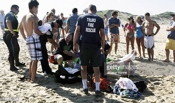 A man is treated for a shark bite on his legs at Cape Cod's Ballston Beach July 30 2012 in Truro Massachusetts There have been numerous shark...