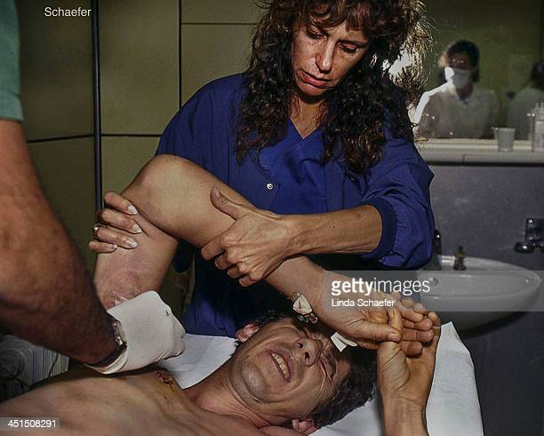 Man is treated for gun shot wound in a Mostar hospital 1993. This was in 1993 when the city was under heavy attack between the Croatians and...