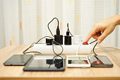 man is turning off  power adapters for mobile phones