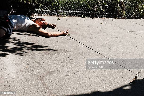 A man is viewed passed out on the street while high on K2 or 'Spice' a synthetic marijuana drug in East Harlem on August 28 2015 in New York City New...