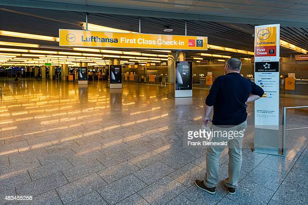 A man is waiting at the First Class Checkin of the airline Lufthansa at Terminal 1 of Frankfurt International Airport