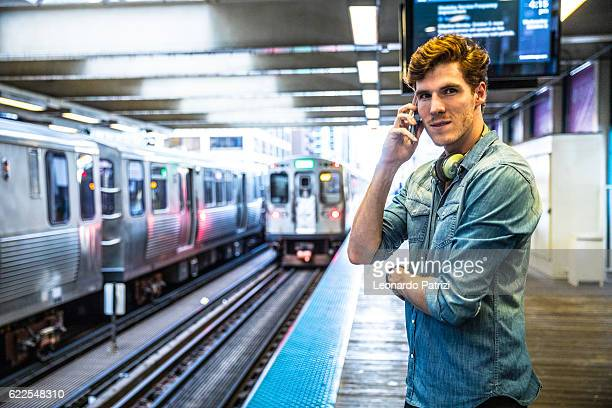 Man is waiting for the subway train in the morning