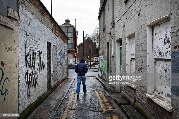 A man is walking in an alley in Bethnal Green East London
