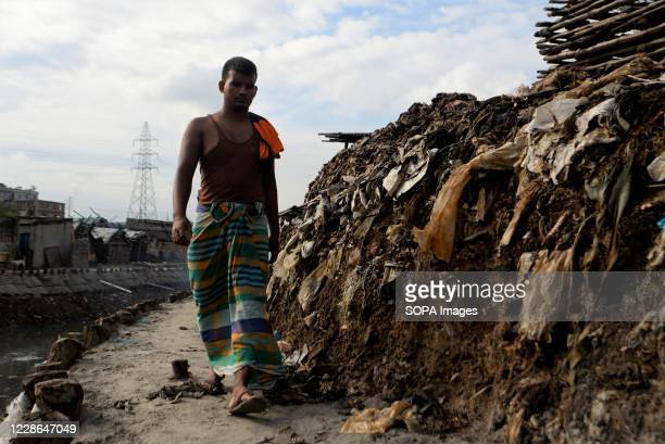 Man is walking in tannery polluted area at Hazaribagh. Most people in this area have become victims of pollution due to the presence of toxic...
