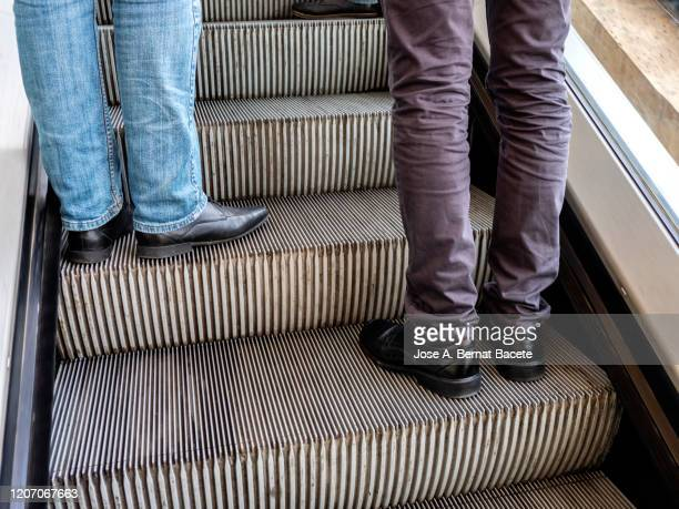 a man is walking up the steps of an underground passage, - metallic shoe stock pictures, royalty-free photos & images