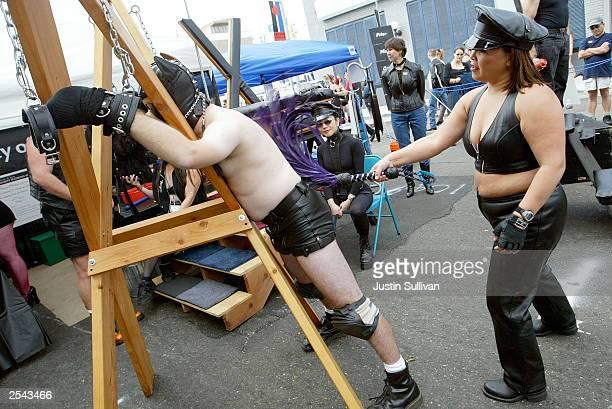 Man is whipped by a woman at the 20th Annual Folsom Street Fair September 28, 2003 in San Francisco, California. The annual fair originally began as...