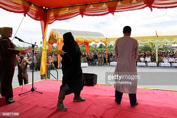 A man is whipped publicly in a caning ceremony at Meulabohm on February 12 2016 in West Aceh Indonesia About 32 men in Aceh were publicly whipped on...