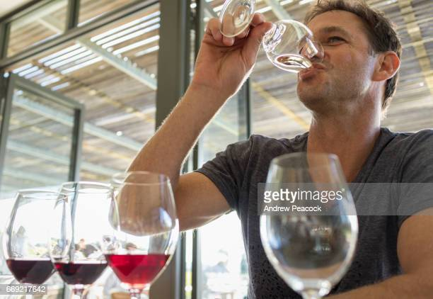 A man is wine tasting in the Adelaide Hills